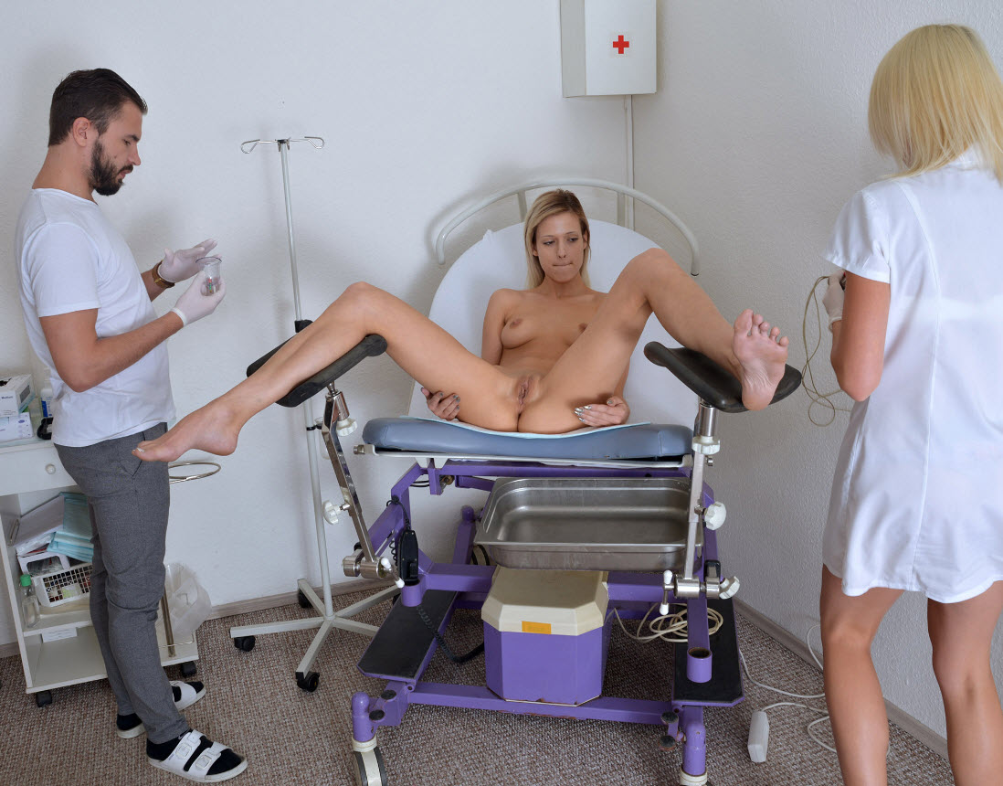 Doctor breasts table exam stirrups legs